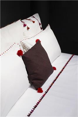 Valerie Barkowski bed linen blanc ILIAS crush pompoms credit tania panova